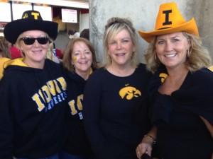 Three Chi-os and a Kappa check out Byrd Stadium