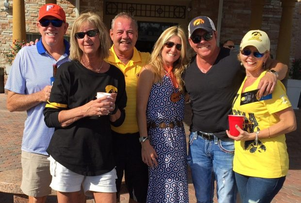 Iowa and Florida fans enjoy the sunshine before  the Outback Bowl